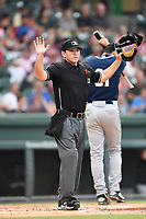Umpire Brandon Blome works a game between the Greenville Drive and Asheville Tourists on Wednesday, August 2, 2017, at Fluor Field at the West End in Greenville, South Carolina. Greenville won, 1-0. (Tom Priddy/Four Seam Images)