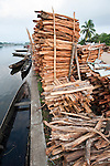 Stacks of illegally collected wood lying on the quayside in Maroantsetra. From the region of Masoala National Park, north east Madagascar. November 2009.