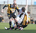 Ayr Utd's Michael Donald is tackled by East Fife's Stephen Hughes and Steven Campbell .