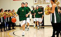21 January 2010: University of Vermont Catamount guard Joey Accaoui, a Junior from Lincoln, RI, dribbles the ball as the team emerges from their locker room prior to a game against the Stony Brook University Seawolves at Patrick Gymnasium in Burlington, Vermont. The Catamounts fell to the Seawolves 65-60 in the America East matchup. Mandatory Credit: Ed Wolfstein Photo