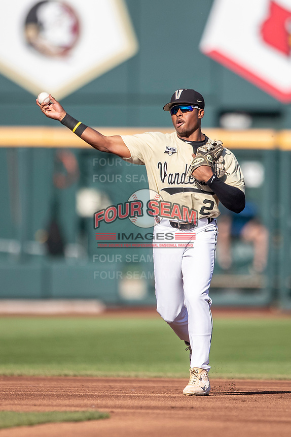 Vanderbilt Commodores second baseman Harrison Ray (2) makes a throw to first base against the Michigan Wolverines during Game 3 of the NCAA College World Series Finals on June 26, 2019 at TD Ameritrade Park in Omaha, Nebraska. Vanderbilt defeated Michigan 8-2 to win the National Championship. (Andrew Woolley/Four Seam Images)