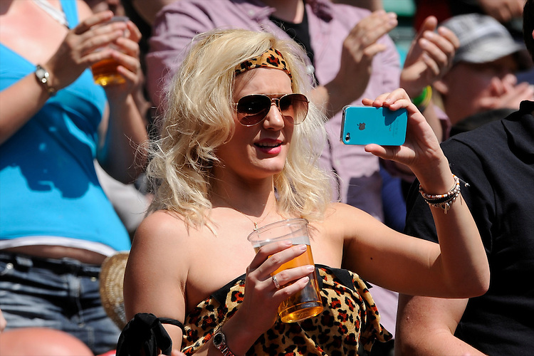 A rugby fan captures the fun during the iRB Marriott London Sevens at Twickenham on Sunday 13th May 2012 (Photo by Rob Munro)