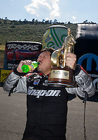 Jul. 21, 2013; Morrison, CO, USA: NHRA funny car driver Cruz Pedregon celebrates after winning the Mile High Nationals at Bandimere Speedway. Mandatory Credit: Mark J. Rebilas-