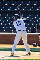 AC Carter (13) of the Georgetown Hoyas at bat against the Marshall Thundering Herd at Wake Forest Baseball Park on February 15, 2014 in Winston-Salem, North Carolina.  The Thundering Herd defeated the Hoyas 5-1.  (Brian Westerholt/Four Seam Images)