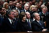 Former Florida Gov. Jeb Bush, Laura Bush and former President George W. Bush listen during a State Funeral for former President George H.W. Bush at the Washington National Cathedral, Wednesday, Dec. 5, 2018, in Washington. <br /> Credit: Alex Brandon / Pool via CNP