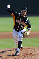 Levi Dean #32 of the Tennessee Volunteers delivers a pitch at Lindsey Nelson Stadium against the the Manhattan Jaspers on March 12, 2011 in Knoxville, Tennessee.  Tennessee won the second game of the double header 3-2.  Photo by Tony Farlow / Four Seam Images..