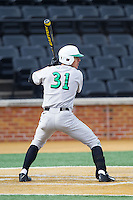 Corey Bird (31) of the Marshall Thundering Herd at bat against the Wake Forest Demon Deacons at Wake Forest Baseball Park on February 17, 2014 in Winston-Salem, North Carolina.  The Demon Deacons defeated the Thundering Herd 4-3.  (Brian Westerholt/Four Seam Images)