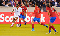 HOUSTON, TX - FEBRUARY 03: Jessica McDonald #14 of the United States moves with the ball past the Costa Ricans during a game between Costa Rica and USWNT at BBVA Stadium on February 03, 2020 in Houston, Texas.