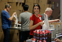 Miss Arkansas USA 2021 Stephanie Barber collects non perishable food items Monday, June 7, 2021, as she volunteers with others at the Northwest Arkansas Food Bank in Springdale. For more information about the Northwest Arkansas Food Bank and opportunities to volunteer visit nwafoodbank.org. Check out nwaonline.com/210608Daily/ and nwadg.com/photos for a photo gallery.<br /> (NWA Democrat-Gazette/David Gottschalk)