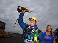 Feb 22, 2015; Chandler, AZ, USA; NHRA funny car driver Matt Hagan celebrates after winning the Carquest Nationals at Wild Horse Pass Motorsports Park. Mandatory Credit: Mark J. Rebilas-
