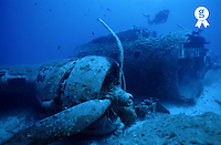 Diver exploring sunken B17 airplane wreck on seabed (Licence this image exclusively with Getty: http://www.gettyimages.com/detail/sb10066226ab-001 )