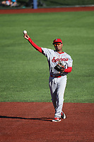 Cristian Inoa (4) of the Spokane Indians throws to first base during a game against the Hillsboro Hops at Ron Tonkin Field on July 23, 2017 in Hillsboro, Oregon. Spokane defeated Hillsboro, 5-3. (Larry Goren/Four Seam Images)