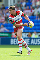 Freddie Burns of Gloucester Rugby passes during the Aviva Premiership match between London Irish and Gloucester Rugby at the Madejski Stadium on Saturday 8th September 2012 (Photo by Rob Munro)