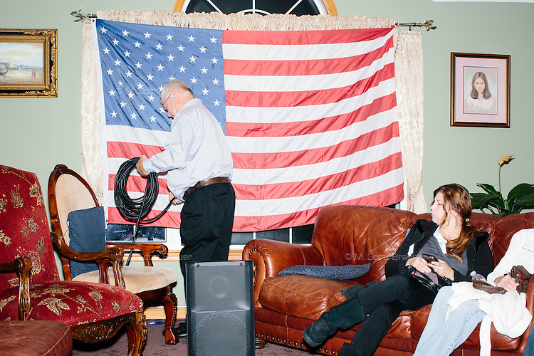 """A man from Analog DB takes down speaker equipment after Texas senator and Republican presidential candidate Ted Cruz greets people spoke at an event called """"Smoke a cigar with Ted Cruz"""" at a house party at the home of Linda & Steven Goddu Salem, New Hampshire. Cruz briefly smoked a cigar after speaking at the event."""