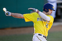 Michigan Wolverines outfielder Jackson Glines (27) follows through on his swing during the NCAA season opening baseball game against the Texas State Bobcats on February 14, 2014 at Bobcat Ballpark in San Marcos, Texas. Texas State defeated Michigan 8-7 in 10 innings. (Andrew Woolley/Four Seam Images)