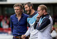 Gareth Ainsworth Manager of Wycombe Wanderers, Barry Richardson first team Coach and Richard Dobson Assistant Manager of Wycombe Wanderers during the Sky Bet League 2 match between Crawley Town and Wycombe Wanderers at Checkatrade.com Stadium, Crawley, England on 29 August 2015. Photo by Liam McAvoy.