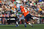 Baltimore, MD - March 17: Midfielder Drew Jenkins #37 of the Syracuse Orangemen attempt to sneak up on Midfielder John Greeley #9 Hopkins during the Syracuse v Johns Hopkins mens lacrosse game at  Homewood Field on March 17, 2012 in Baltimore, MD.(Ryan Lasek/Eclipse Sportswire)