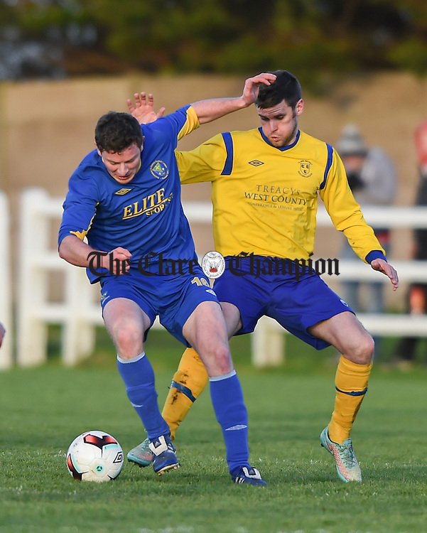 Gregory Grogan of  Roscommon  in action against Eoin O Brien of Clare during their Oscar Traynor game in Frank Healy park, Doora. Photograph by John Kelly.
