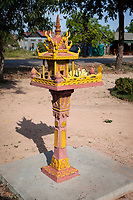 Cambodia.  Roadside Shrine at a Country Road Intersection.