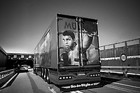"""Switzerland. Canton Bern. Neuhof. A truck rides the A1 motorway on the outskirts of Bern. A semi-trailer is a trailer without a front axle. It belongs to the Müller company and is painted with Muhammad Ali boxing. Muhammad Ali (born Cassius Marcellus Clay Jr.; January 17, 1942 – June 3, 2016) was an American professional boxer, activist, and philanthropist. Nicknamed """"The Greatest"""", he is widely regarded as one of the most significant and celebrated sports figures of the 20th century and as one of the greatest boxers of all time.  7.05.2020 © 2020 Didier Ruef"""