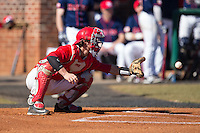 Belmont Abbey Crusaders catcher Drew Sipp (5) warms up the pitcher between innings of the game against the Shippensburg Raiders at Abbey Yard on February 8, 2015 in Belmont, North Carolina.  The Raiders defeated the Crusaders 14-0.  (Brian Westerholt/Four Seam Images)