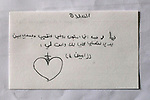 """18/10/14. Erbil, Iraq. A note from Wassam to his uncle Salam, """"Lord, I give my soul and body completely to you to hold."""""""