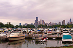 Boats fill a marina in Lincoln Park on Lake Michigan, with the Chicago skyline in the background