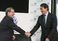 Quebec city mayor Regis Labeaume, left, and Pierre-Karl Peladeau, CEO of Quebecor, shake hand after a press conference at the City hall in Quebec city, Tuesday March 1, 2011. Paladeau and Labeaume discussed the details of Quebecor investment as private partner in a new arena.<br /> <br /> PHOTO :  Francis Vachon - Agence Quebec Presse