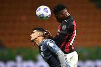 Fabio Depaoli of Benevento Calcio and Rafael Leao of AC Milan compete for the ball during the Serie A football match between AC Milan and Benevento Calcio at San Siro Stadium in Milano  (Italy), May 1st, 2021. Photo Matteo Gribaudi / Image Sport / Insidefoto