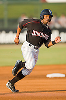 Kyle Colligan #23 of the Kannapolis Intimidators hustles towards third base against the Greenville Drive at Fieldcrest Cannon Stadium June 3, 2010, in Kannapolis, North Carolina.  Photo by Brian Westerholt / Four Seam Images