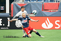 FOXBOROUGH, MA - APRIL 17: Connor Presley #7 of New England Revolution II slides to tackle Juan Pablo Monticelli #2 of Richmond Kickers during a game between Richmond Kickers and Revolution II at Gillette Stadium on April 17, 2021 in Foxborough, Massachusetts.
