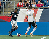 FOXBOROUGH, MA - JUNE 26: Cristian Penilla #70 dribbles at midfield as Alejandro Bedoya #11 defends during a game between Philadelphia Union and New England Revolution at Gillette Stadium on June 26, 2019 in Foxborough, Massachusetts.