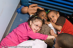 Education Preschool 3-4 year olds group posing and playing horizontal
