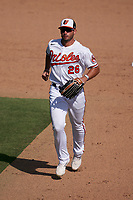 Baltimore Orioles outfielder Chris Shaw (26) jogs to the dugout during a Major League Spring Training game against the Philadelphia Phillies on March 12, 2021 at the Ed Smith Stadium in Sarasota, Florida.  (Mike Janes/Four Seam Images)