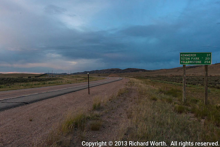 A two lane highway in southwest Wyoming's high desert at dusk.