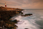 Portland Bill Lighthouse with rocks and waves, Dorset, UK