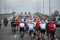 peloton over a bridge<br /> <br /> 71st Dwars door Vlaanderen (1.HC)