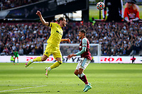 3rd October 2021;   City of London Stadium, London, England; EPL Premier League football, West Ham versus Brentford; Mathias Jensen of Brentford heads the ball away from Pablo Fornals of West Ham United