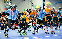 16 MAR 2014 - BIRMINGHAM, GBR - Wizards of Aus jammer Sausarge Rolls (centre) races from the Argentine blockers during the inaugural Men's Roller Derby World Cup in the Futsal Arena in Birmingham, West Midlands, Great Britain (PHOTO COPYRIGHT © 2014 NIGEL FARROW, ALL RIGHTS RESERVED)