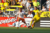 24 JULY 2010:  Corey Ashe of the Houston Dynamo (26) and Robbie Rogers of the Columbus Crew (18) during MLS soccer game between Houston Dynamo vs Columbus Crew at Crew Stadium in Columbus, Ohio on July 3, 2010. Columbus defeated the Dynamo 3-0.