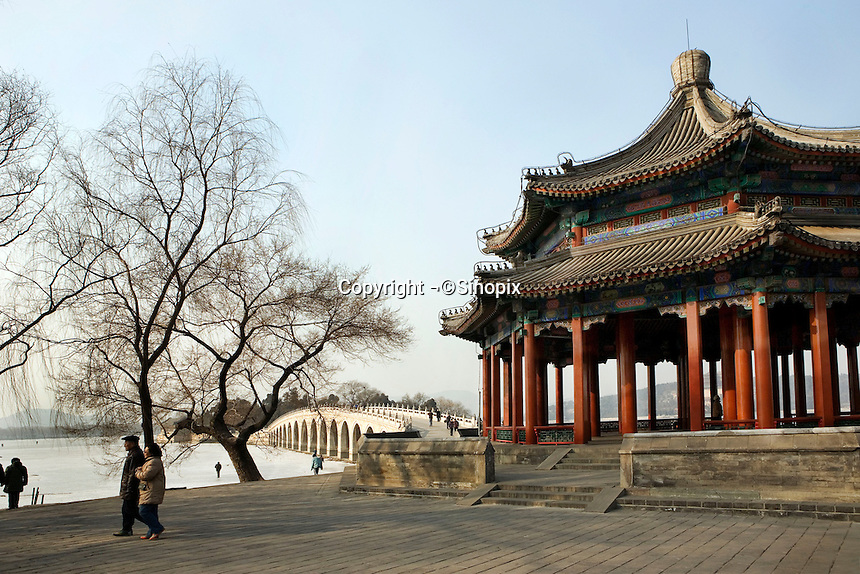 Pagoda and the Seventeen-Arch bridge at the Summer Palace. The Summer Palace, a palace 15km from Beijing, is mainly dominated by Longevity Hill (60 meters high) and Kunming Lake. It covers an expanse of 2.9 square kilometers, three quarters of which is water..Beijing. .Dec 2005