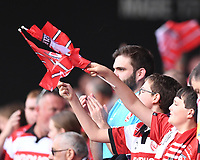 9th October 2021; Kingsholm Stadium, Gloucester, England; Gallagher Premiership Rugby, Gloucester versus Sale Sharks;  Gloucester fans celebrate narrowly winning the match