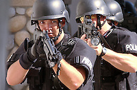 Tracy SWAT officer Mark Duxbury leads members of the Tracy SWAT team into a home  in Tracy California. They were there for training.