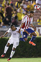Pasadena, CA - Tuesday June 07, 2016: Colombia defender Farid Díaz (19) and Paraguay defender Paulo Da Silva (14) during a Copa America Centenario Group A match between Colombia (COL) and Paraguay (PAR) at Rose Bowl Stadium.