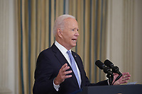 U.S. President Joe Biden speaks in the State Dining Room of the White House in Washington, D.C., U.S., on Friday, Sept. 24, 2021. The U.S. will begin giving Covid-19 booster shots to millions of Americans today, a watershed moment in the nation's battle against the pandemic that officials <br /> Credit: Al Drago / Pool via CNP /MediaPunch