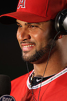 Albert Pujols  #5 of the Los Angeles Angels is interviewed after a game against the New York Yankees at Angel Stadium on May 29, 2012 in Anaheim,California. Los Angeles defeated New York 5-1.(Larry Goren/Four Seam Images)