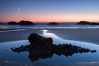 Twilight and crescent moon over the Oregon coast.