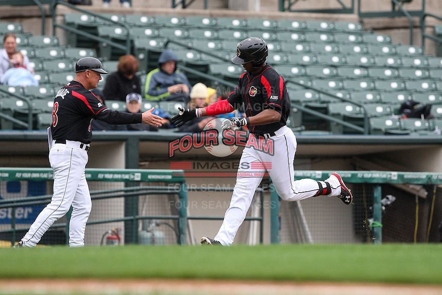 Left fielder Adam Walker (30) of the Rochester Red Wings is congratulated by manager Mike Quade after hitting a solo homerun in the bottom of the 5th inning against the Scranton Wilkes-Barre Railriders on May 1, 2016 at Frontier Field in Rochester, New York. Red Wings won 1-0.  (Christopher Cecere/Four Seam Images)