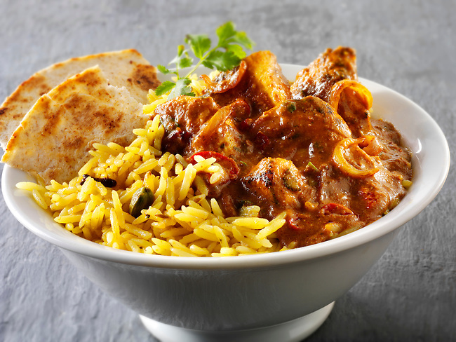 Chickien Madras, pilau rice & chipati. Traditional Indian curry