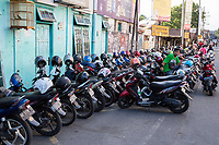 Yogyakarta, Java, Indonesia.  Motorbike Parking Area and Attendant, just off Jl. Laksda Adisucipto Street.